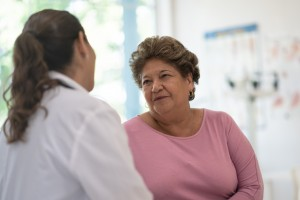 Hispanic senior speaking with doctor