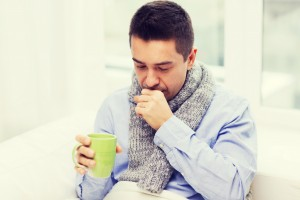 man coughing from acute bronchitis