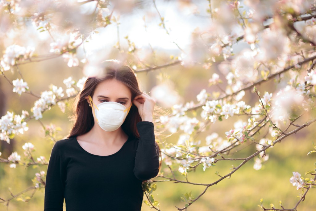 Woman with Respirator Mask Fighting Spring Allergies or COVID-19