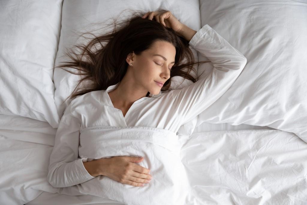 Women peacefully sleeping in bed